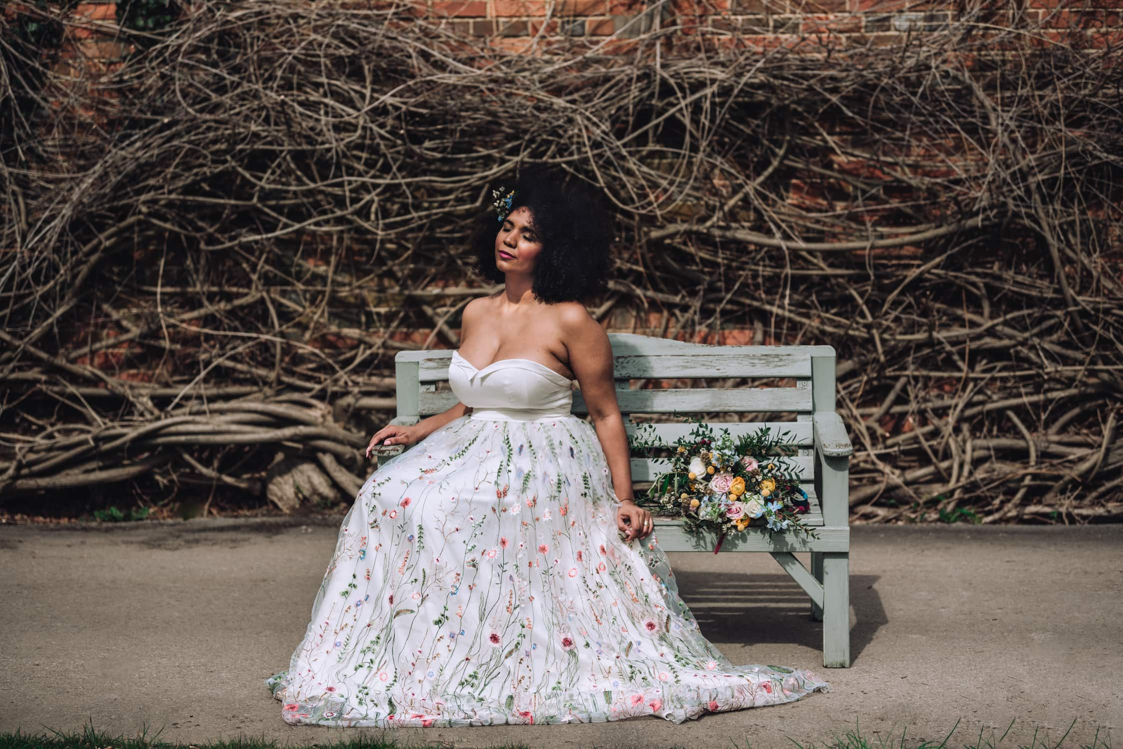 Black Bride in a white wedding dress with a floral pattern