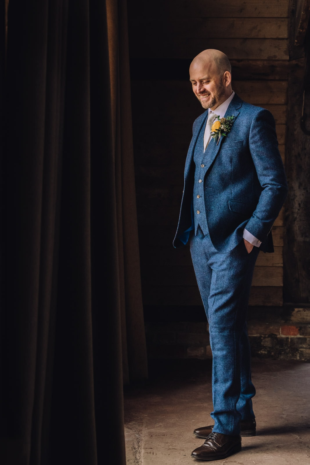 Smiling Groom Standing in a blue suit in Pangbourne