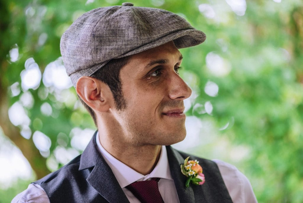 Groom in tears wearing a flat hat