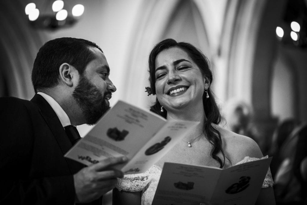 black and white photo of a bride smiling with closed eyes